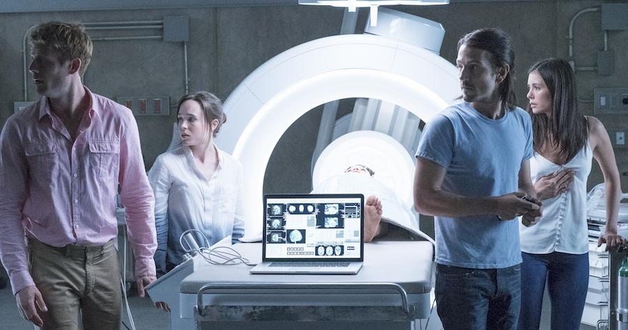 Jamie (James Norton), Courtney (Ellen Page) Ray (Diego Luna), and Marlo (Nina Dobrev) hear something  in Columbia Picutres' FLATLINERS.