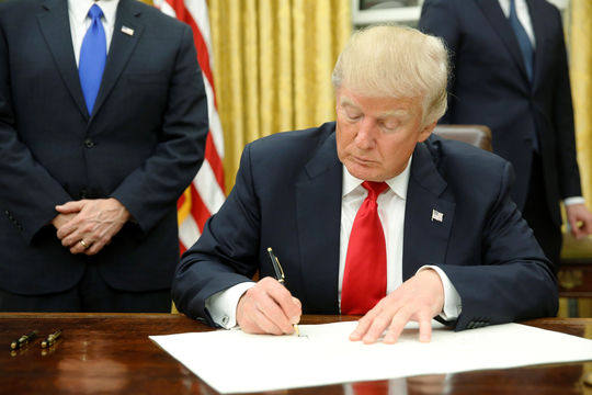 Donald Trump signs first executive order as president