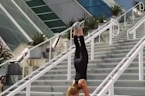 Girl Walks down Stairs on Hands