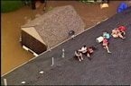 Kansas family stranded on roof due to severe flooding