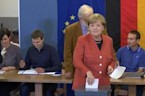 Chancellor Angela Merkel votes in election her conservatives are expected to win