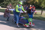 WATCH: Ghosts, ghouls and members of the New Albany Fire Department race coffins down the New Albany Riverfront