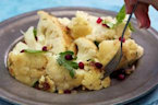 How to Make Whole Roasted Cauliflower with Pomegranate and Pine Nuts