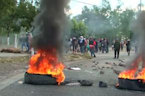 Police clash with protesters blocking roads over electoral crisis