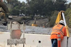 Crews Continue Digging Out a Flooded 101 Freeway