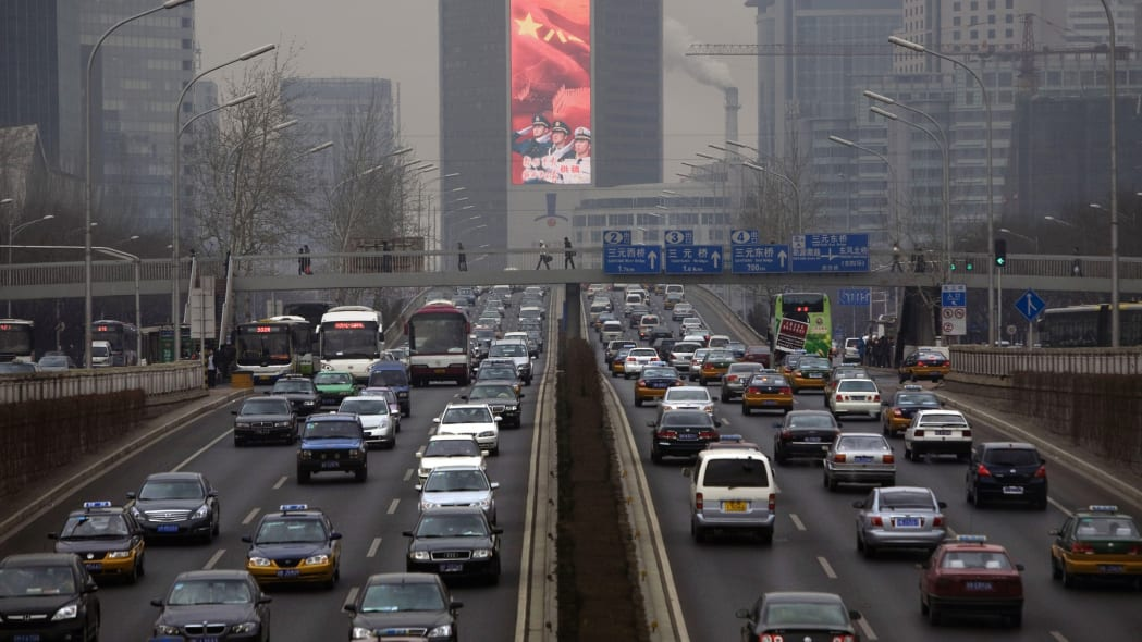 China Traffic (Heavy traffic along a major thoroughfare in Beijing, China, Tuesday, Feb 17, 2009. Beijing's crowded and polluted streets have seen a sharp increase of nearly 66,000 vehicles this year,