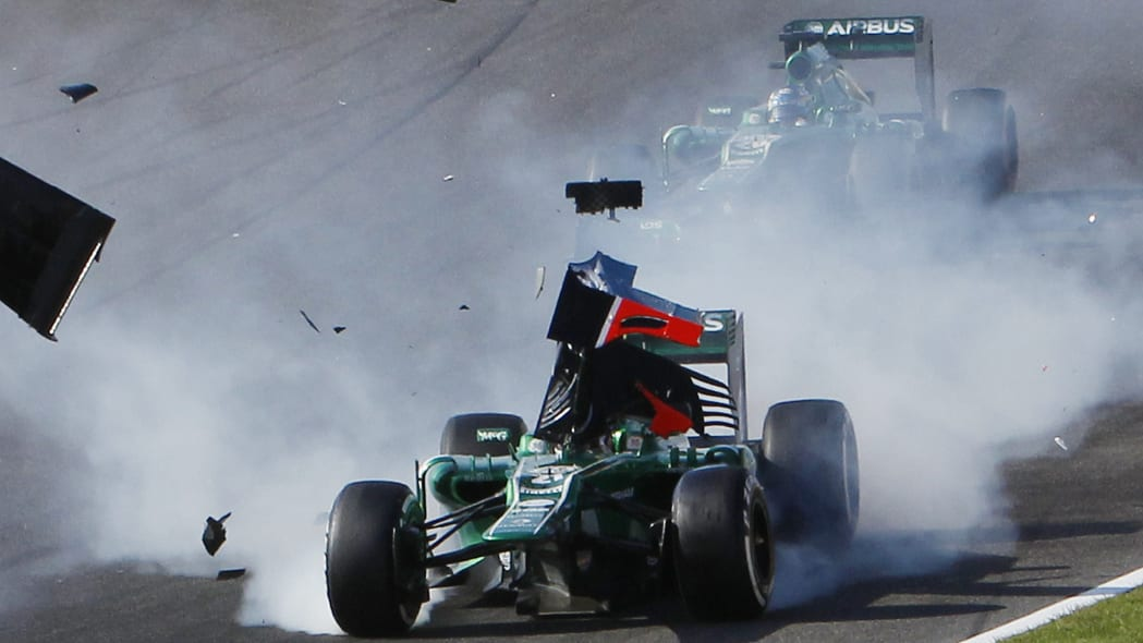 APTOPIX Japan F1 GP Auto Racing (The wing of Marussia driver Jules Bianchi flies across the car of Caterham driver Giedo van der Garde of the Netherlands, after they collided at the start of the Japan
