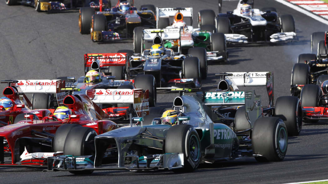 Japan F1 GP Auto Racing (Mercedes driver Lewis Hamilton of Britain, foreground, steers his car through turn 2 at the start of the Japanese Formula One Grand Prix at the Suzuka circuit in Suzuka, Japan