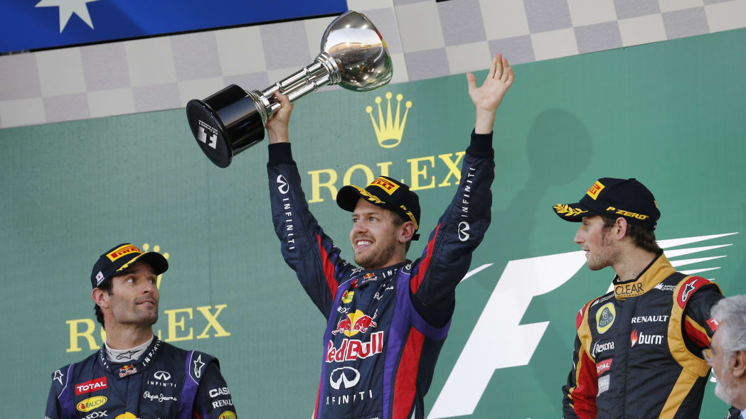 APTOPIX Japan F1 GP Auto Racing (Red Bull driver Sebastian Vettel of Germany celebrates with the trophy after winning the Japanese Formula One Grand Prix at the Suzuka circuit in Suzuka, Japan, Sunday
