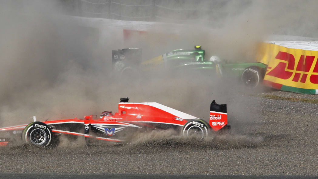 Japan F1 GP Auto Racing (Marussia driver Jules Bianchi, front, and Caterham driver Giedo van der Garde of the Netherlands crash at the start of the Japanese Formula One Grand Prix at the Suzuka circui