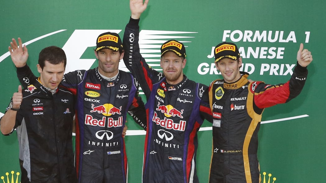 Japan F1 GP Auto Racing (Red Bull driver Sebastian Vettel of Germany, second right,  celebrates along with second placed teammate  driver Mark Webber of Australia, second left,  and third placed Lotus
