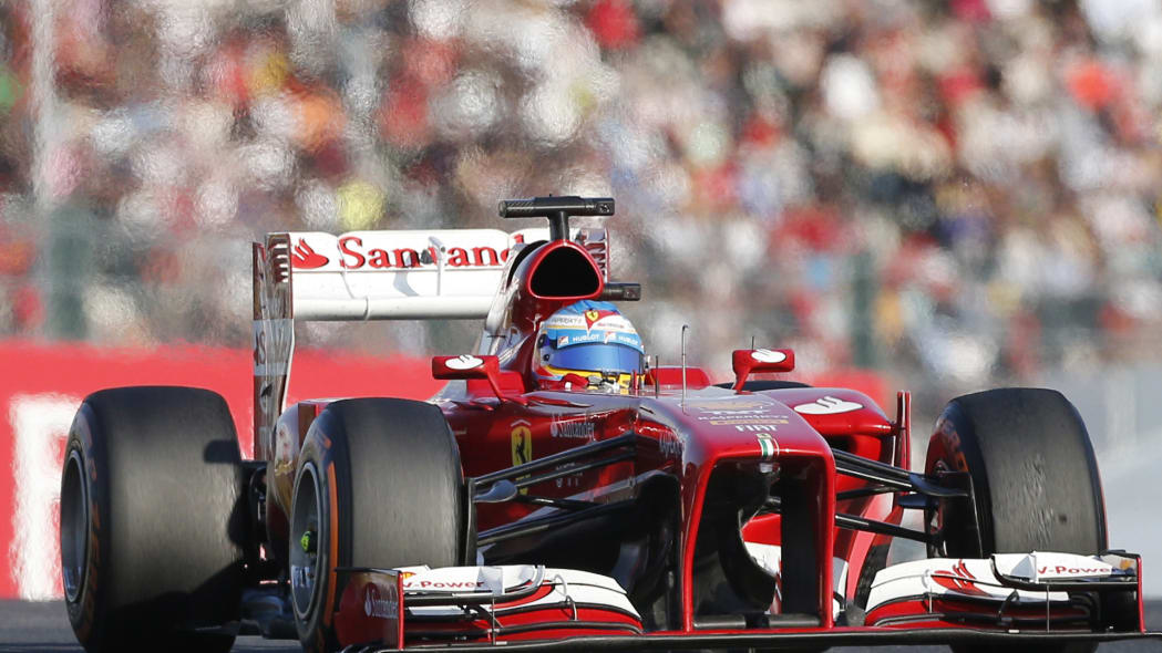 Japan F1 GP Auto Racing (Ferrari driver Fernando Alonso of Spain steers his car during the Japanese Formula One Grand Prix at the Suzuka circuit in Suzuka, Japan, Sunday, Oct. 13, 2013.(AP Photo/Koji