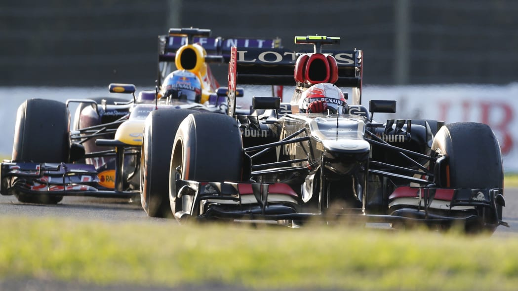 Japan F1 GP Auto Racing (Lotus driver Romain Grosjean of France, right, and Red Bull driver Sebastian Vettel of Germany compete during the Japanese Formula One Grand Prix at the Suzuka circuit in Suzu