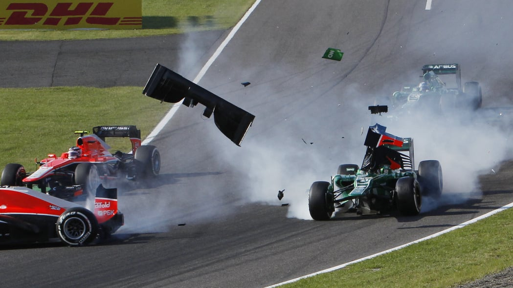 Japan F1 GP Auto Racing (Caterham driver Giedo van der Garde of the Netherlands, right, and Marussia driver Jules Bianchi, left, collide at the start of the Japanese Formula One Grand Prix at the Suzu