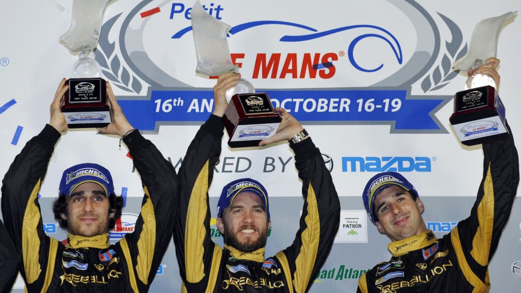 ALMS Petit Le Mans Auto Racing (From left, Nicolas Prost, of France; Nick Heidfeld, of Germany; and Neel Jani, of Switzerland, celebrate on the podium after taking the overall win at the American Le M