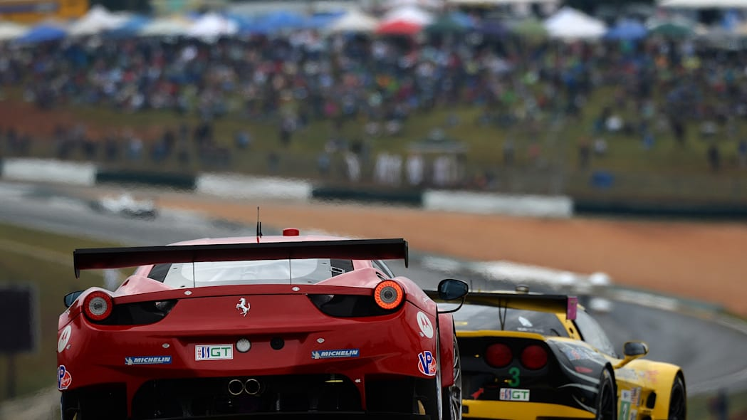 Petit Le Mans Auto Racing (Matteo Malucelli, of Italy, drives the Risi Competizione Ferrari F458 as he follows Jan Magnussen (3), of Denmark, in the Chevrolet Corvette C6.R during the American Le Mans