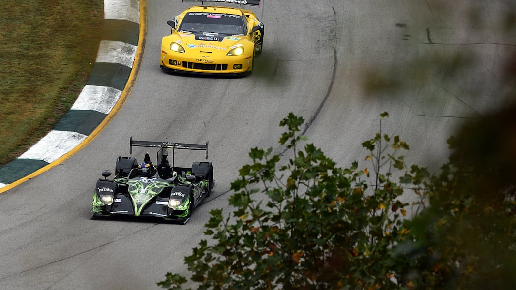 Petit Le Mans Auto Racing (David Brabham (01), of Australia, drives the Extreme Speed Motorsports HPD ARX-03b as Oliver Gavin, of England, follows in the Chevrolet Corvette C6 ZR1during practice for t