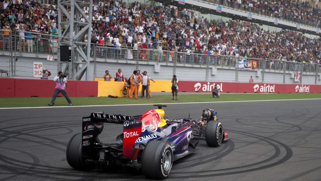 India F1 GP Auto Racing (Red Bull driver Sebastian Vettel of Germany celebrates on the track after winning the Indian Formula One Grand Prix and his 4th straight F1 world drivers championship at the B