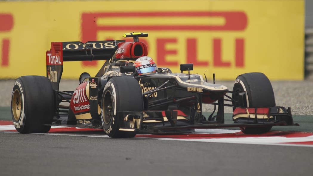 India F1 GP Auto Racing (Lotus driver Romain Grosjean of France steers his car during the Indian Formula One Grand Prix at the Buddh International Circuit in Noida, India, Sunday, Oct. 27, 2013. (AP P