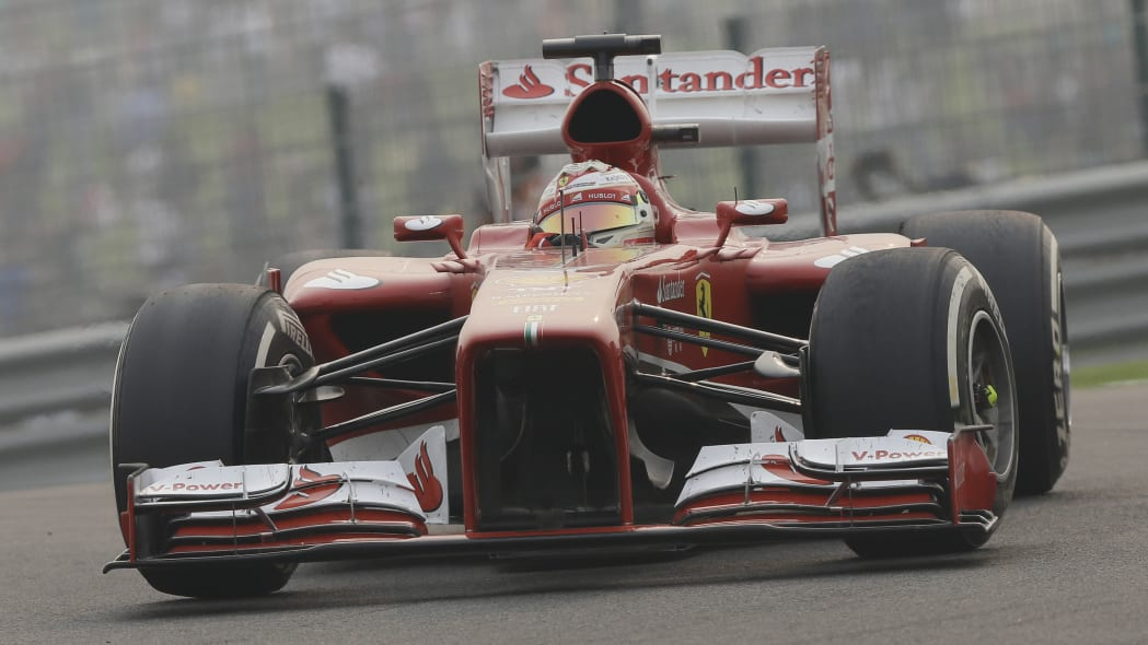India F1 GP Auto Racing (Ferrari driver Fernando Alonso of Spain steers his car during the Indian Formula One Grand Prix at the Buddh International Circuit in Noida, India, Sunday, Oct. 27, 2013. (AP