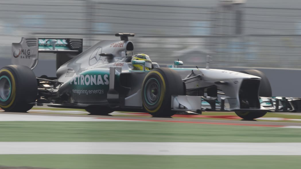India F1 GP Auto Racing (Mercedes driver Lewis Hamilton of Britain steers his car during qualifying at the Indian Formula One Grand Prix at the Buddh International Circuit in Noida, India, Saturday, O