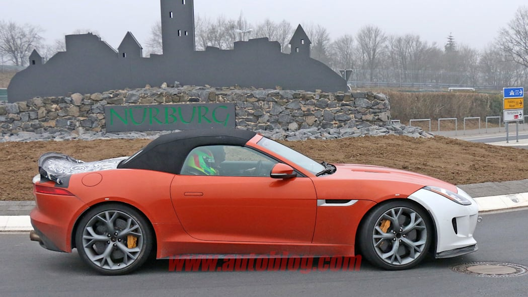 orange jaguar f-type r-s spy shots at nurburgring spoiler