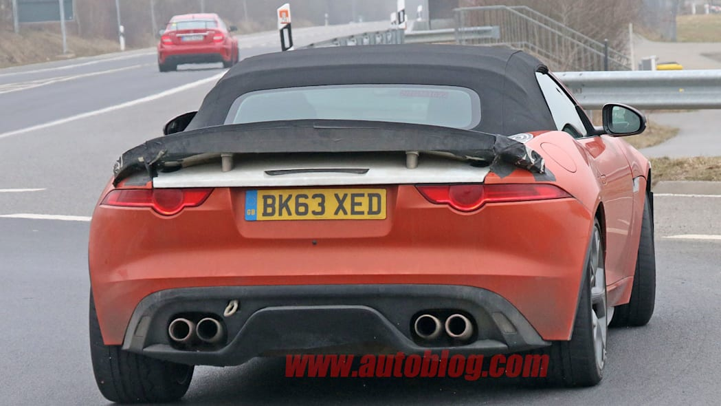 orange jaguar f-type r-s spy shots at nurburgring exhausts