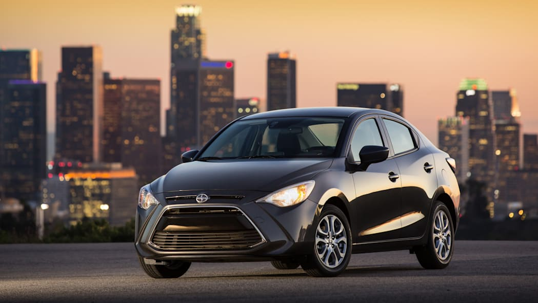 2016 Scion iA in dark grey with city skyline