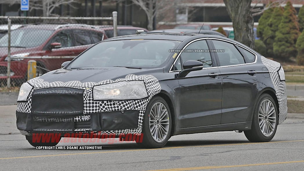 camouflaged 2017 ford fusion spy shot three quarters