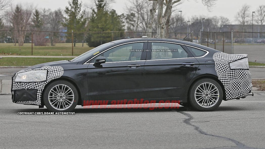 camouflaged 2017 ford fusion spy shot profile