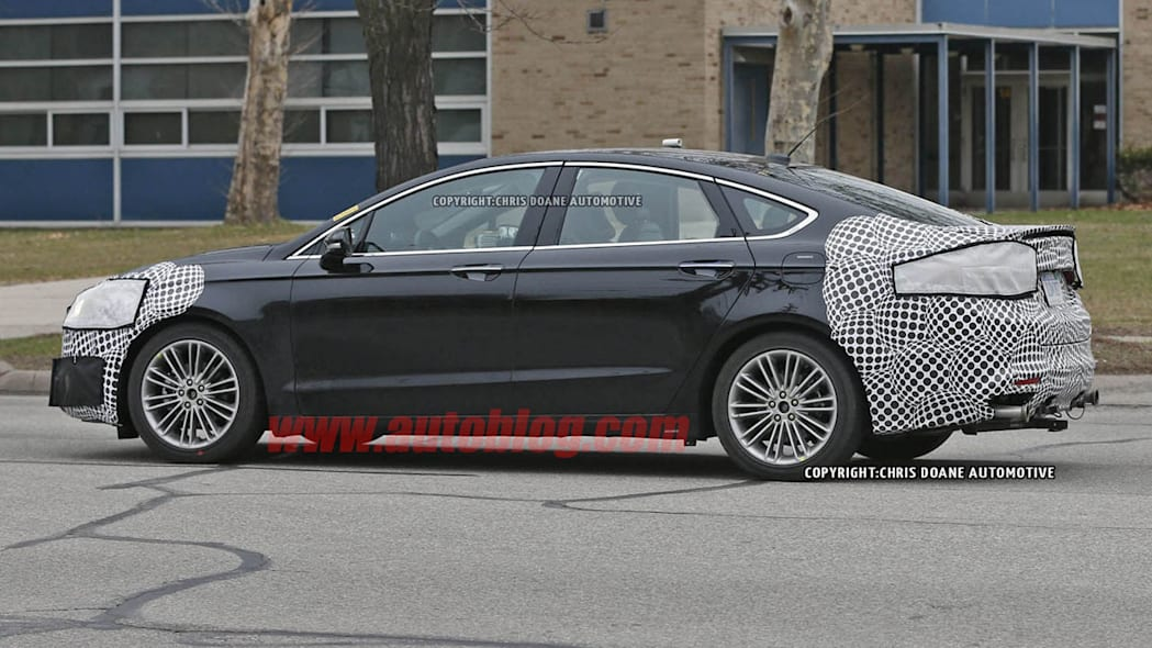 camouflaged 2017 ford fusion spy shot rear