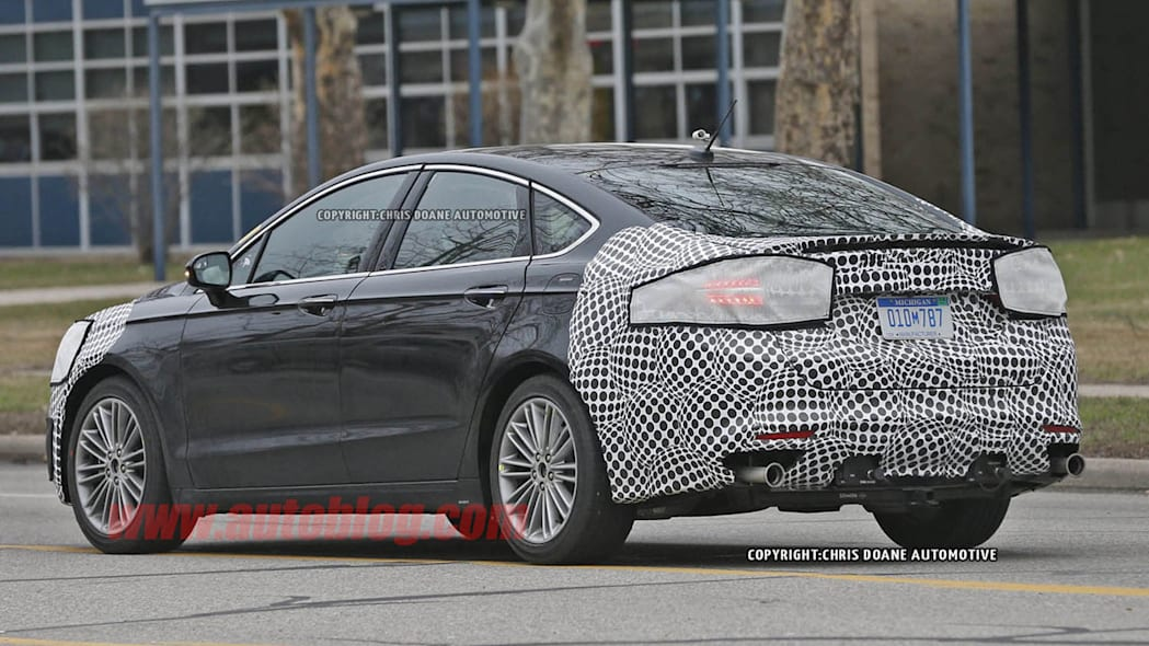 camouflaged 2017 ford fusion spy shot back