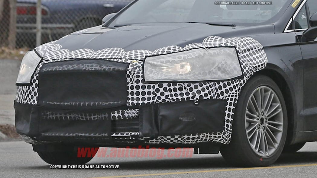 camouflaged 2017 ford fusion spy shot front closeup