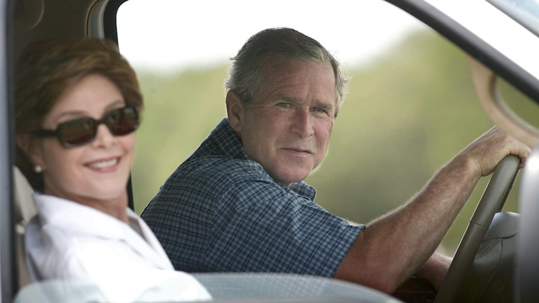 Former US President George W. Bush and First Lady Laura Bush in Ford truck