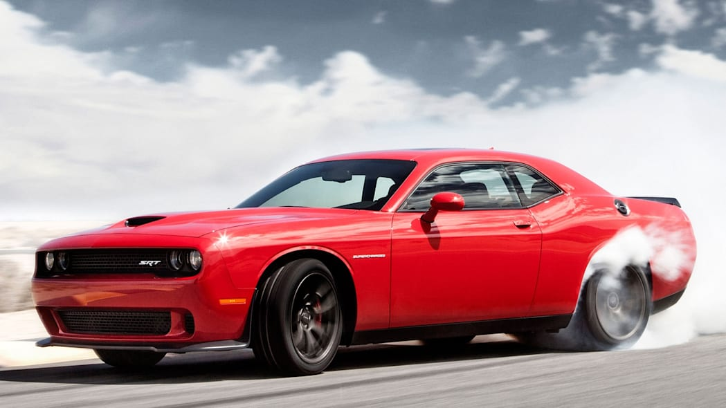 Dodge Challenger SRT Hellcat in red doing a burnout