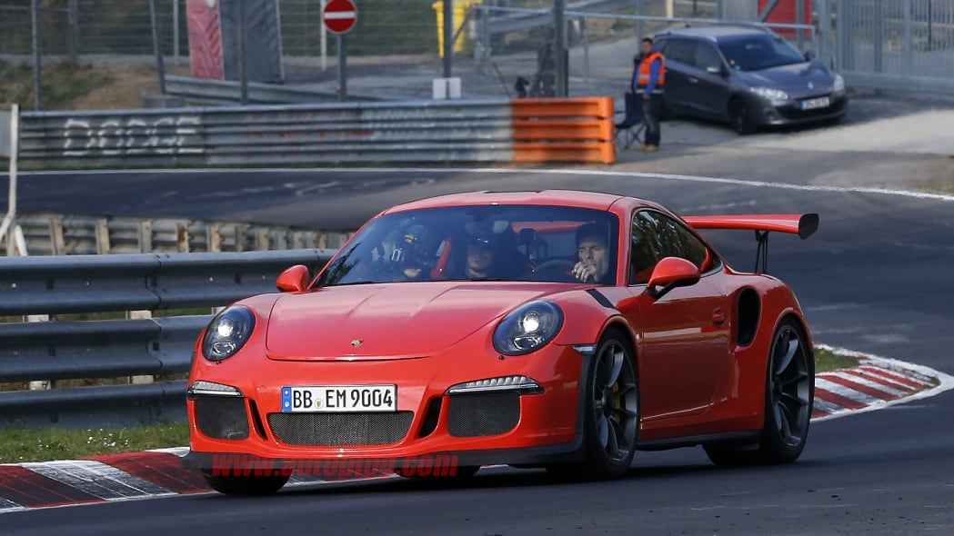 Mark Webber does promotional work in the new Porsche 911 GT3 RS at the Nuerburgring, front three-quarter view.