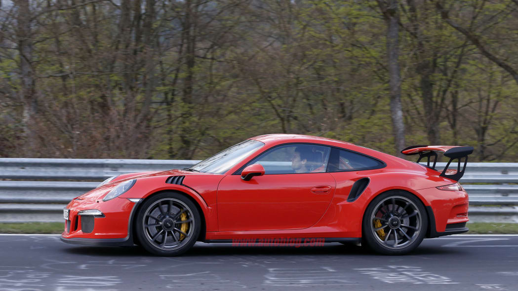 Mark Webber does promotional work in the new Porsche 911 GT3 RS at the Nuerburgring, side view.