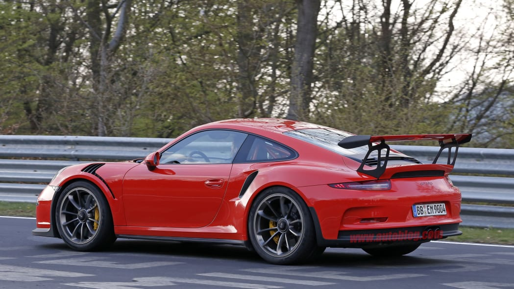 Mark Webber does promotional work in the new Porsche 911 GT3 RS at the Nuerburgring, rear three-quarter view.