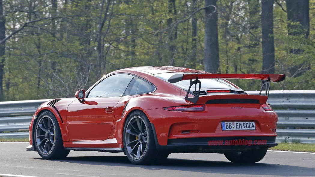 Mark Webber does promotional work in the new Porsche 911 GT3 RS at the Nuerburgring, rear view.