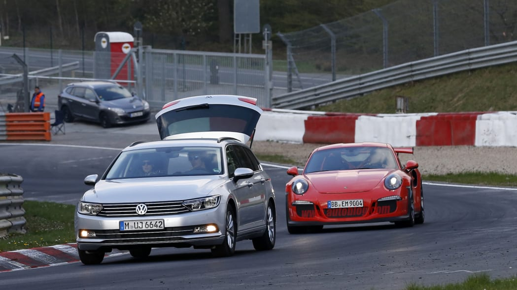 Mark Webber does promotional work in the new Porsche 911 GT3 RS at the Nuerburgring, front view.