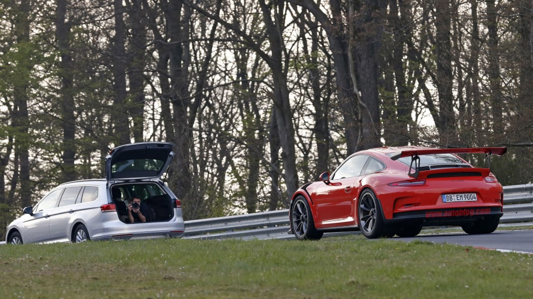 Mark Webber does promotional work in the new Porsche 911 GT3 RS at the Nuerburgring, rear view with camera car.