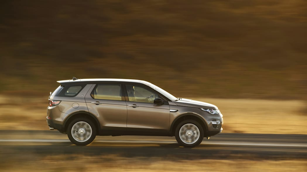 Land Rover Discovery Sport Ingenium diesel moving road side brown