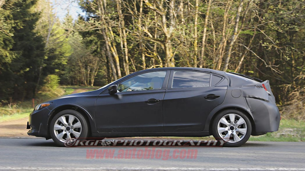black honda civic five-door profile