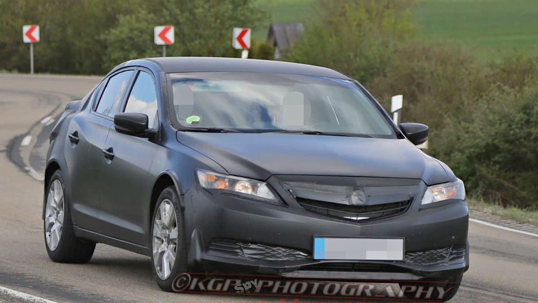 black honda civic five-door camouflaged front