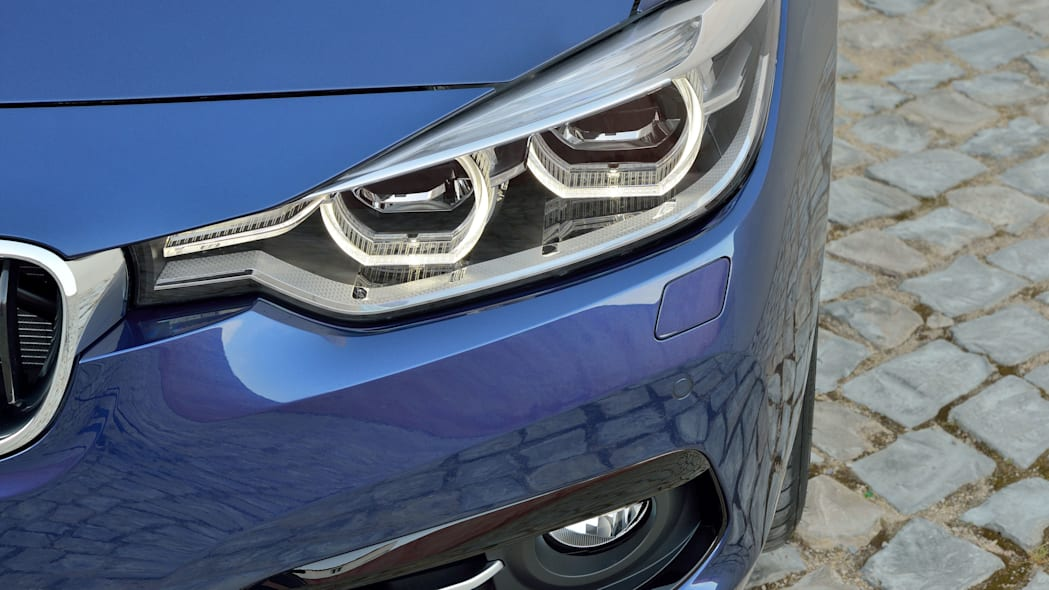 blue 2016 bmw 3 series refresh headlights closeup