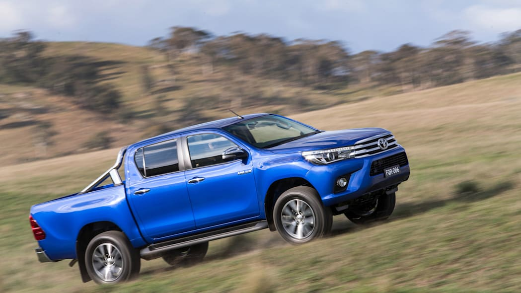 2016 Toyota HiLux pickup truck driving uphill