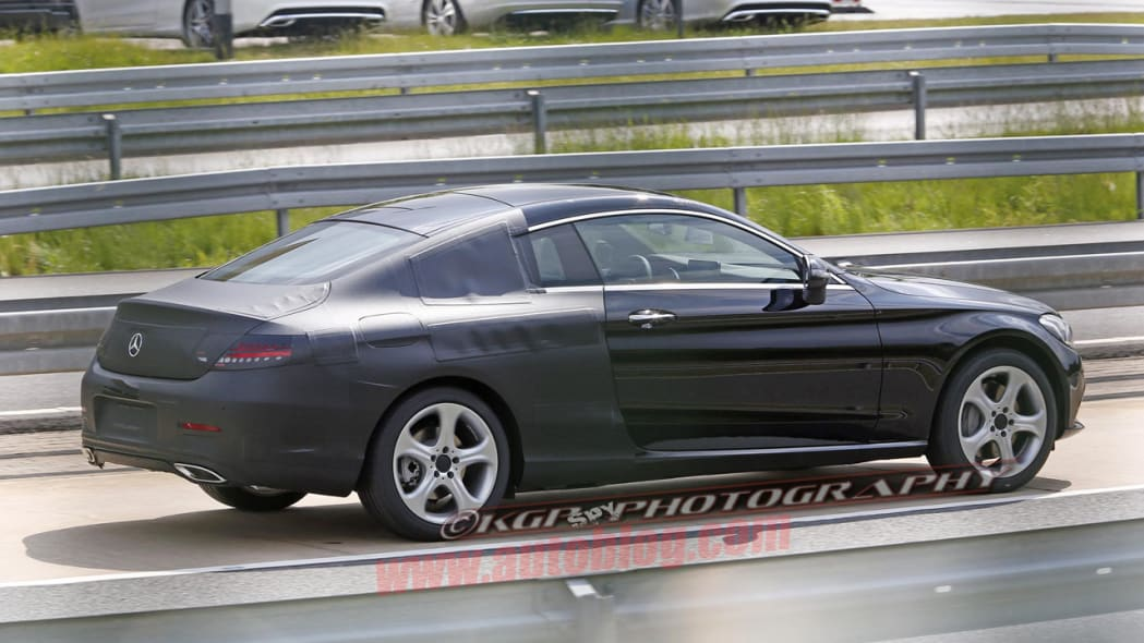 black mercedes-benz c-class coupe spy shot rear camouflage