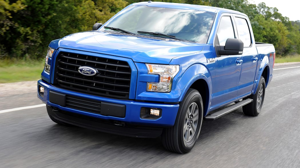 2015 Ford F-150 in blue driving