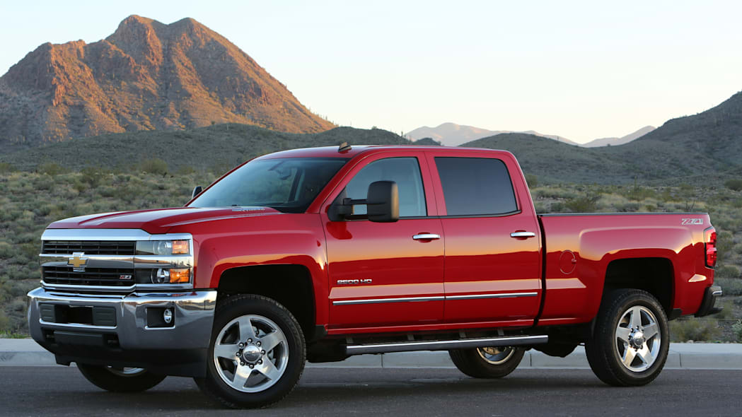 2015 Chevy Silverado in red with mountains