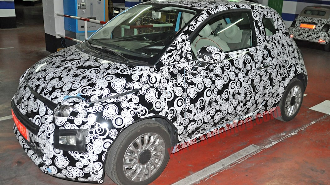 camouflaged fiat 500 three quarters refresh spy shots